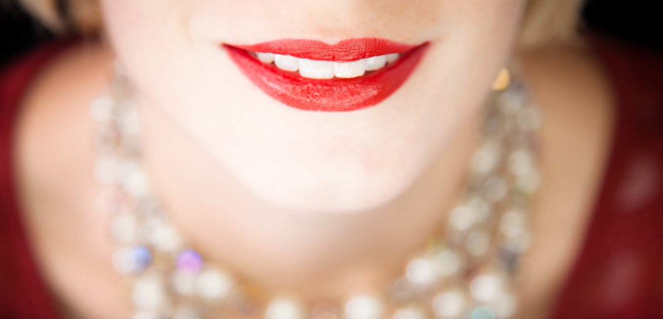 Woman's face with red lips ready to shine for public speaking